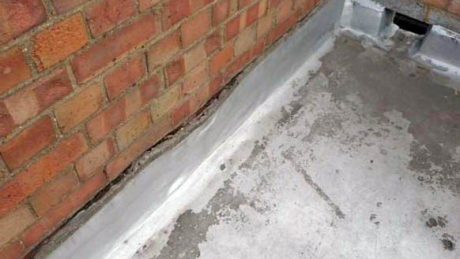 Slumping of asphalt skirting allows water ingress